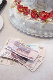 Money about a wedding pie on a table Royalty Free Stock Photo