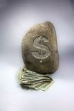Money weighted down. A concept photo Royalty Free Stock Photography