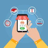 Hand holding smartphone with online shopping icon vector design. Money is what many people take for selling their own things or services Royalty Free Stock Photography