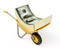 Money in wheelbarrow Stock Image