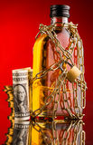 Money and whisky bottle Royalty Free Stock Images