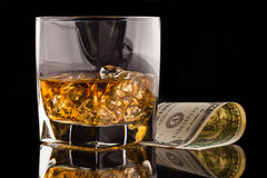 Money and whisky glass Royalty Free Stock Photos