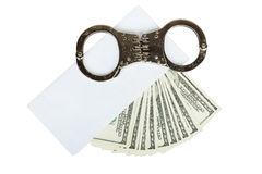 Money in a white envelope with handcuffs Stock Image