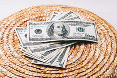 Money on Wicker surface Royalty Free Stock Image