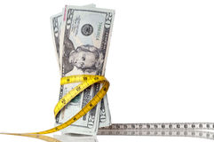 Money With A Tape Measure Royalty Free Stock Photography