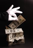 Money wizard. White gloved hands holding money Stock Photo