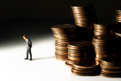 Money woes. Business figure with money stock image