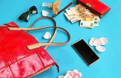Money and Woman Accessories Red Wallet with money euro Red handbag perfume black Sunglass And Gold Shoes on High Heels on Blue. Classy and fabulous Quotes Of stock image