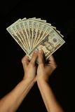 Money in Woman's Hands. A woman holding a fold of money Royalty Free Stock Image