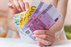 Money in womens hands Royalty Free Stock Photo