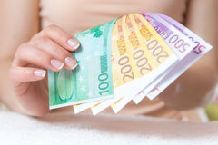 Money in womens hands Stock Images