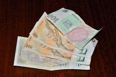 Money on wood Stock Image
