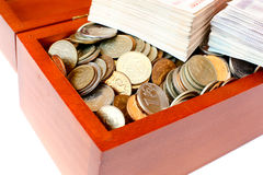 Money in wooden box Stock Image