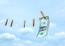 Money with wooden clothespin. On clothes line Stock Photography