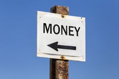 Money word and arrow signpost Stock Photos