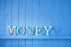 Business Money Finance Background. A blue painted wood background with the word money on it royalty free stock image