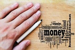 Money word cloud business concept. Over wooden background royalty free stock images