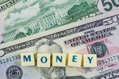 Money word on dollar background. Finance concept. Finance concept with dollar background and money word Royalty Free Stock Photos
