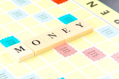 Money word on game board Stock Photos