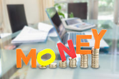 Money wording on coins stack Royalty Free Stock Photos