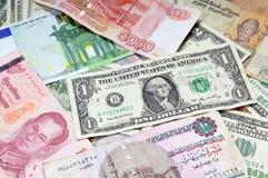 Money of the world. Dollars, euros, russian rubles, thai baht, turkish lira, egypt pounds Stock Photography