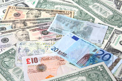 Money. World currencies. A texture of world currencies: U.S. dollars, pounds and euros. Banknotes Stock Image