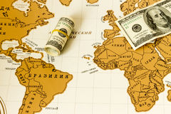 Money is on the world map Stock Photography