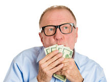 Money worship Stock Images