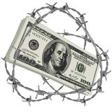 Money wrapped in barbed wire Stock Photo