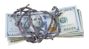 Money Wrapped in Barbed Wire Royalty Free Stock Photo