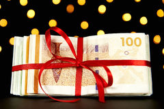 Money wrapped for a christmas present Royalty Free Stock Images