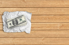 Money on a wrinkled paper Stock Photos