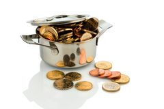 Money wuro coins. A cooking pot is filled with euro coins, symbolic photo for grants and subsidies Stock Images