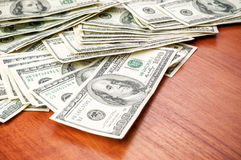 Money & X28;dollars& X29; On The Table Stock Image