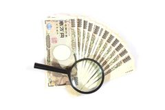 Money yen banknotes under magnifying glass.  Stock Image