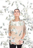Money. Young business woman with paper bags full of money and money banknotes flying in air on the white background Royalty Free Stock Image