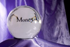 Money in your Future. A crystal ball with a prediction of Money Stock Image