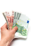 Money in your hand. Hand holding a stack of cash on white Royalty Free Stock Photo
