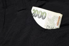 Money in your pocket. Money in your pocket black pants-two thousand Czech crowns stock photography