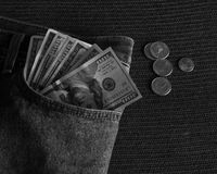 Money in Your Pocket pants B&W. One Hundred Dollar bills sticking out of a pants pocket Royalty Free Stock Photo