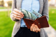 Money in your wallet. A man pulls money out of his wallet. Business concept, earnings, money stock photo