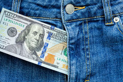 Money in a zipper. Money in a zipper, dollars looks out of a zipper of jeans Stock Photo
