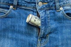 Money in a zipper. Money in a zipper, dollars looks out of a zipper of jeans Stock Photos