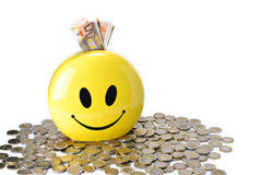 Moneybox. Yellow, Smiling Moneybox isolated on white background Stock Images