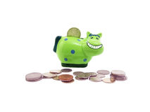 Moneybox. Cow with coins from diffrent country Stock Image