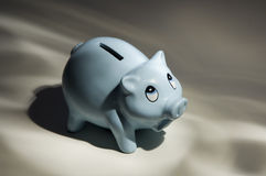 Moneybox. Piggy moneybox with a sad look Royalty Free Stock Photography