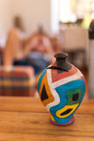 Moneybox. Colorful moneybox in a house. Save money Stock Photo