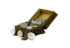 Moneybox 4. Full open wooden vintage moneybox filled with silver shine and dull coins Royalty Free Stock Image