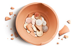 Moneybox crash. Broken moneybox and coins view from above Stock Photography