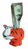 Moneybox del tigre del juguete de los niños con los dólares fotografía de archivo libre de regalías